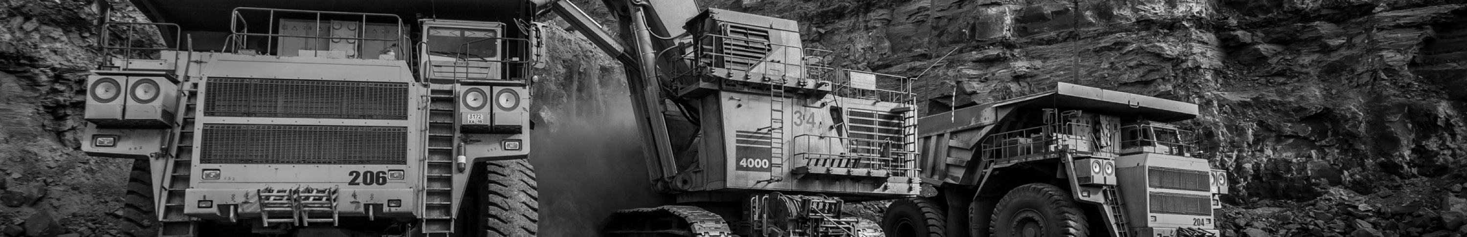 Sears Mining Products. Picture of three large mining machines.
