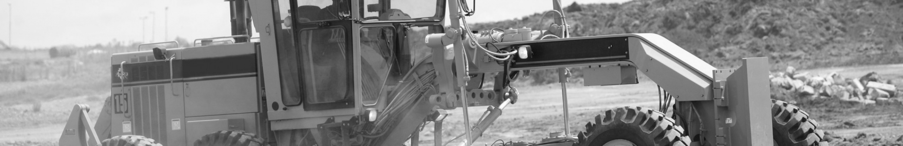 Sears Motor Grader Products. Picture of a motor grader working.